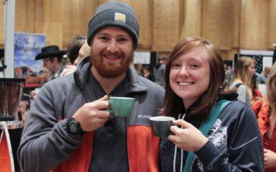 Two people posing with espressos at the cincinnati coffee festival